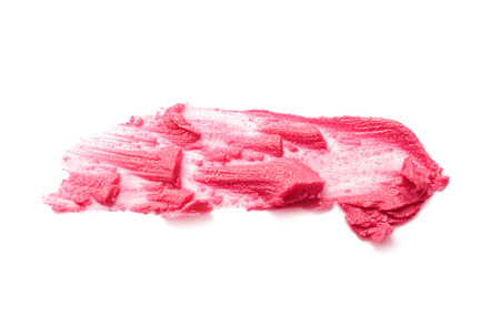 Smudge of lipstick on white background. Professional cosmetics Banque d'images