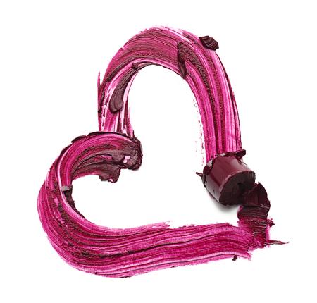Smudge of lipstick on white background. Professional cosmetics Stock Photo