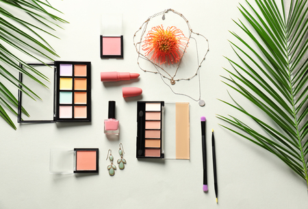 Set of decorative cosmetics and accessories on light background, flat lay
