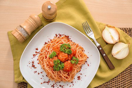 Plate with spaghetti and meatballs on table. Delicious pasta recipes 写真素材