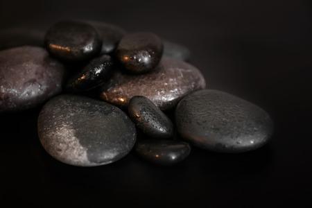 Pile of spa stones on dark background 免版税图像