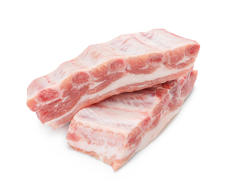 Raw ribs on white background