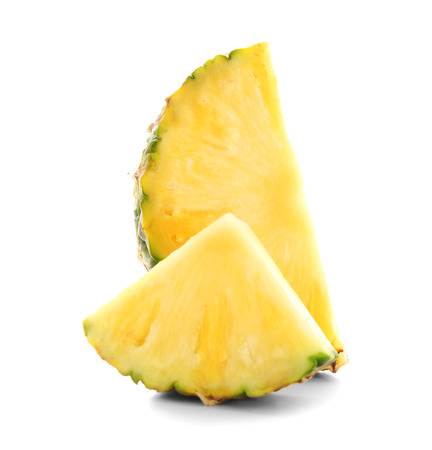 Slices of juicy pineapple on white background