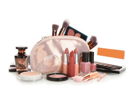 Make-up bag and set of decorative cosmetics on white background
