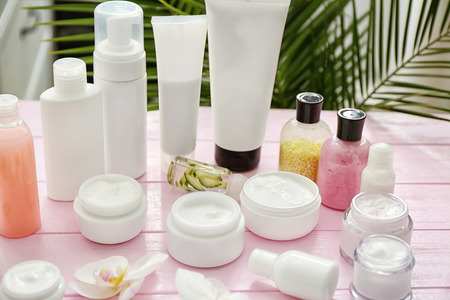 Set of natural cosmetics on wooden table