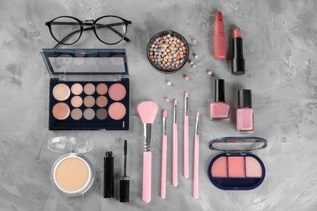 Flat lay composition with professional cosmetics on grey background Standard-Bild