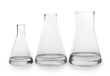 Chemical glassware with water on white background