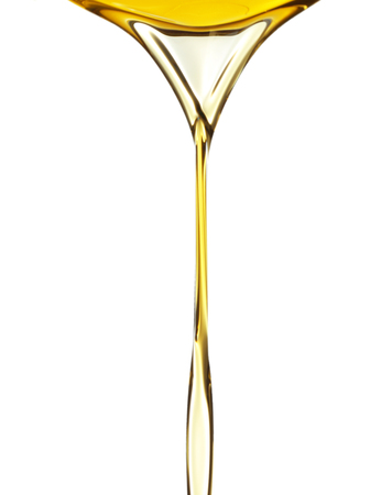Pouring fresh olive oil on white background