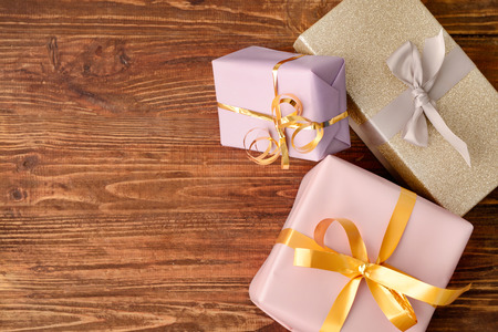 Gift boxes on wooden background, top view