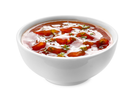 Tasty tomato sauce in bowl on white background Фото со стока