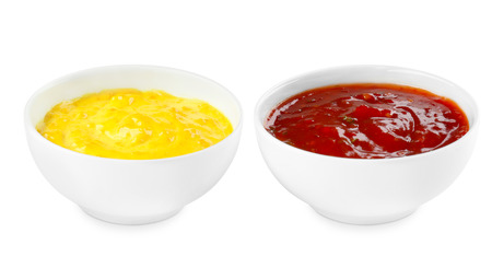 Tasty sauces in bowls on white background