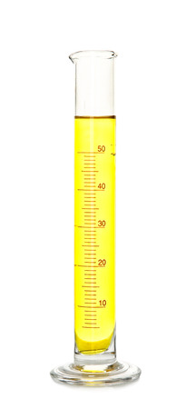 Graduated cylinder with color sample on white background 写真素材