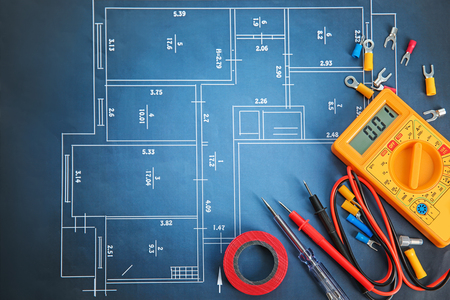 Flat lay composition with electrical tools on house plan 免版税图像 - 112924348