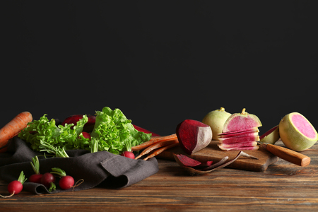 Composition with ripe fresh vegetables on wooden table