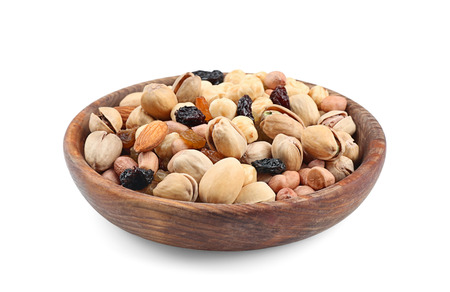 Plate with different nuts and dried berries on white background