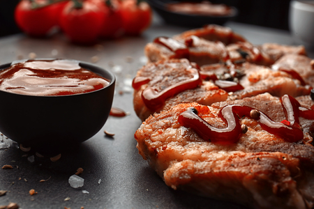 Delicious grilled meat with barbecue sauce on table, closeup Stok Fotoğraf
