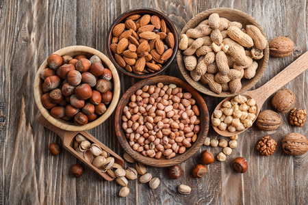 Flat lay composition with different kinds of nuts on wooden background 스톡 콘텐츠