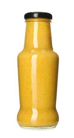 Bottle with tasty mustard sauce on white background
