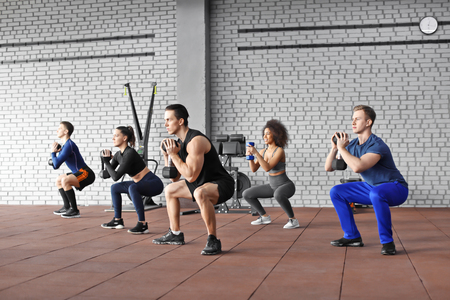 Group of athletes working out in gym