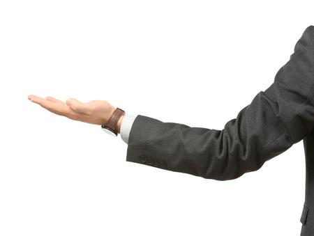 Young businessman holding something on white background Stockfoto