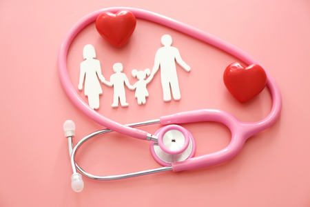 Family figure, red hearts and stethoscope on color background. Health care concept Stock Photo