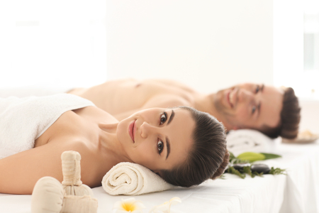 Young couple relaxing in spa salon
