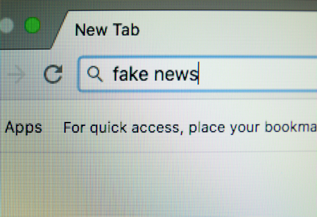 Page of internet browser with words FAKE NEWS in address bar