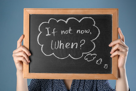 Woman holding chalkboard with phrase
