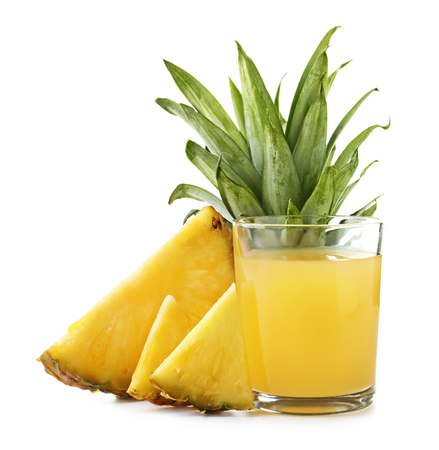 Glass of sweet juice with pineapple slices on white background Stock Photo