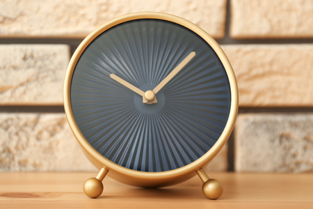 Modern clock on wooden table. Time management concept