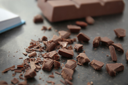 Delicious chocolate shavings on table, closeup