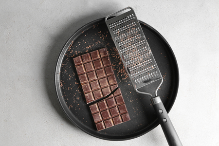 Delicious chocolate with grater on plate Archivio Fotografico - 113161318