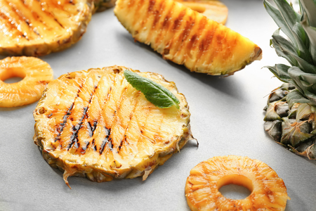 Grilled pineapple slices on table