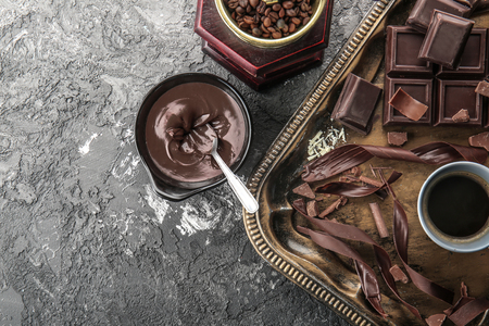 Composition with delicious chocolate and cup of coffee on table Stock Photo