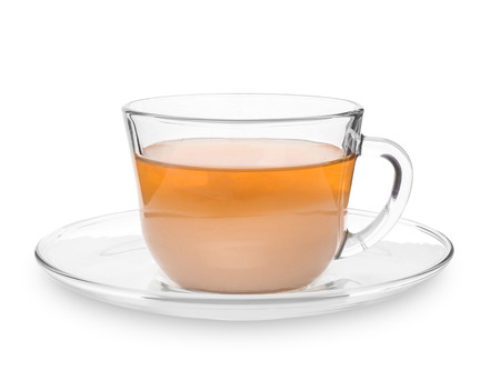 Glass cup of aromatic tea with milk on white background