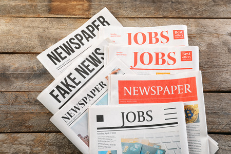 Newspapers on wooden background