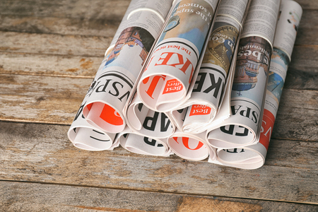 Rolled newspapers on wooden background Archivio Fotografico - 113166505