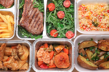 Different containers with delicious food as background. Delivery service