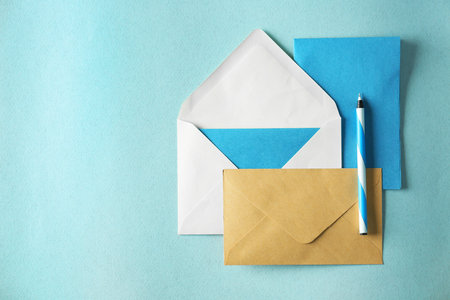 Paper envelopes on color background Stock Photo