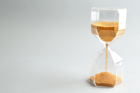 Hourglass on light background. Time management concept