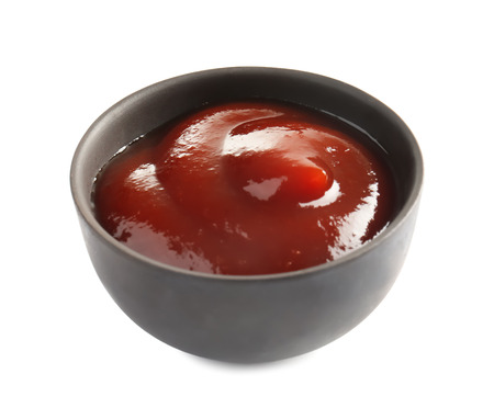 Bowl with barbecue sauce on white background