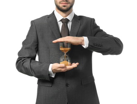 Man holding hourglass on white background. Time management concept Stockfoto