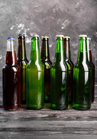 Fresh beer in glass bottles on table