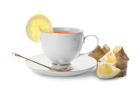 Cup of delicious tea with ginger and lemon on white background