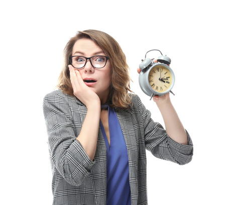Mature woman with alarm clock on white background. Time management concept