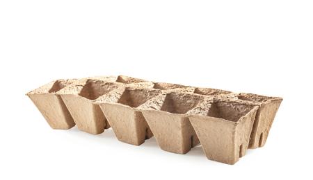 Peat pots kit for gardening on white background