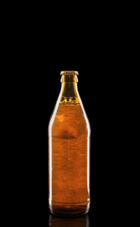 Bottle of beer on dark background