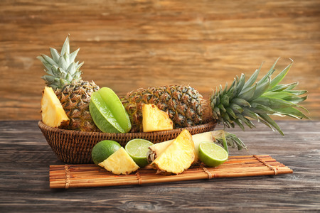 Composition with ripe fresh pineapple on wooden table