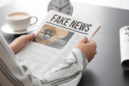 Woman reading morning newspaper indoors Stockfoto