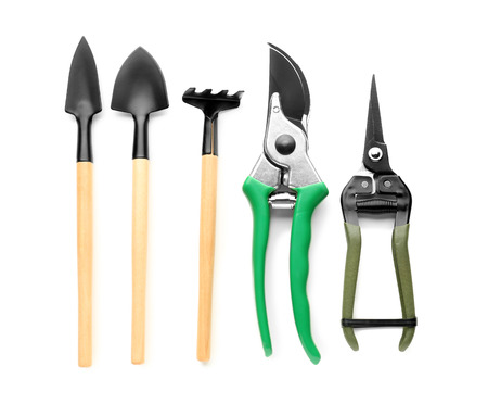 Gardening tools on white background